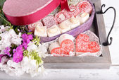 Present box with sweets — Stock Photo
