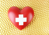 Red heart with cross sign — Stock Photo