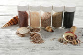Different sea salt in bottles — Foto de Stock