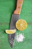 Fresh lime, knife and salt — Stock Photo