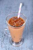 Glass of iced milk coffee — Stock Photo