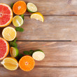 Different sliced juicy citrus fruits — Stock Photo #50020643