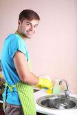 Man washing dish — Stock Photo