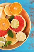 Different sliced juicy citrus fruits — Foto de Stock