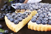 Tasty homemade pie with blueberries on wooden table — Stockfoto