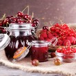 Berries jam in glass jar on table, close-up — Stock Photo #50216157