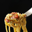 Italian pasta spaghetti on fork on black background — Stock Photo #50219599