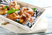 Tasty buns with berries on tray on table close-up — Foto Stock