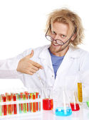 Crazy scientist with tubes — Stock Photo