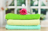 Towels with fragrant flower — Stock fotografie