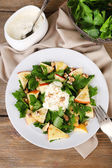 Green salad with apples, walnuts and cheese on wooden background — Stock Photo