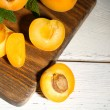 Ripe apricots with mint leaves — Stock Photo #50322809