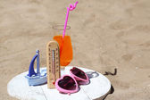 Thermometer in summer sand — Stock Photo