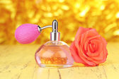 Perfume bottle with rose — Stock Photo