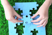 Hands holding puzzle piece — Stock Photo