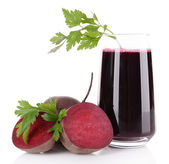 Glass of fresh beet juice and vegetables — Stock Photo