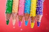 Colorful pencils in water — Stock Photo