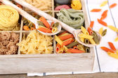 Colorful pasta in wooden box — Stock Photo