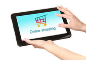 Concept for Internet shopping: hands holding tablet isolated on white — Stock Photo