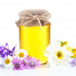 Fresh honey and wild flowers — Stock Photo #50444827