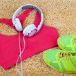 Sport clothes, shoes and headphones on color carpet background. — Stock Photo #50446731