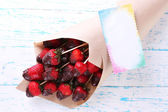 Strawberry in chocolate on skewers — Foto Stock