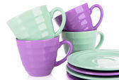 Bright cups and saucers — Stock Photo