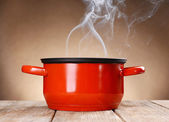 Cooking pot with steam — Stock Photo