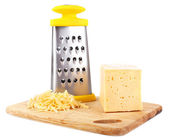 Metal grater and cheese — Stock Photo