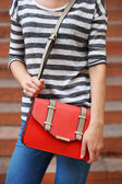 Girl with bag over  shoulder — Stock Photo