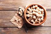 Brown sugar cubes in bowl — Stockfoto