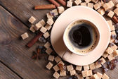 Brown sugar, spices and cup of coffee — Stockfoto