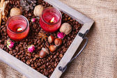 Candles on vintage tray with coffee grains and spices, bumps on sackcloth background — Stock Photo