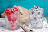 Ice cubes with raspberry — Stock Photo