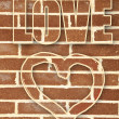 Graffiti heart on brick wall — Stock Photo #50543097
