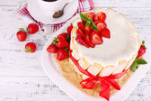 Tasty cake Charlotte with fresh strawberries on wooden table — Stock Photo
