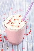 Delicious milkshake on table — Stock Photo