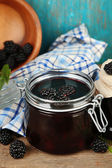 Tasty blackberry jam and fresh berries — Stock Photo