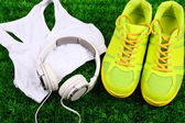 Sport clothes, shoes and headphones — Stock Photo
