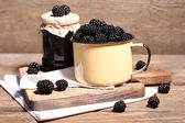 Sweet blackberries in color mug — Stock Photo