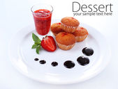 Tasty muffins on plate isolated on white — ストック写真