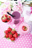 Delicious smoothie on table — Stockfoto