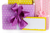 Gift boxes with blank label close up — Stock Photo