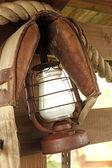 Kerosene lamp on wooden fence — Stock Photo