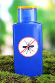 Bottle with mosquito repellent cream on nature background — Stock Photo