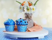 Tasty cupcake on table — Stock Photo
