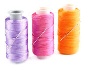Needles and spools of thread — Stock Photo