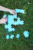 Hand holding puzzle piece — Stock Photo