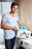 Man with basket of laundry — Stock Photo