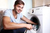 Man with washing machine — Stock Photo